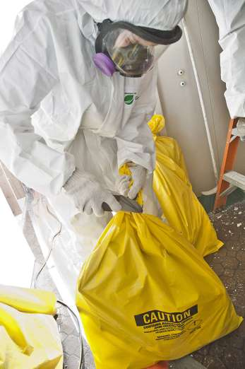 EnviroDoctors_Asbestos-Cleanup-worker-in-Bio-Hazard-Suit-with-Hazardous-Waste-Bag 2